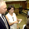 Pine Tree High School Principal Kevin Stanford, lefts visits with OCS teacher Kimberly Barnett, right, as they discuss new school photo ID badges Wednesday july 31, 2002 at the school in Longview. KeviN green