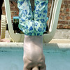 Dustin Nicholson,13, wactches in amazement as a diver dives in the pool at Longview Swim center,Tuesday July 30,2002.Ricardo B.Brazziell