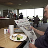 Barry Sutton kills time in the new diner at  Gregg County Airport while he enjoys a meal and reads the newspaper Monday July 29 ,2002 Ricardo B.Brazziell