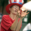 Jeremy Bozman, 15, closes his eyes and hopes for the best during the water balloon toss at the Old Glory Day festival in Carthage Saturday June 29, 2002. Les Hassell