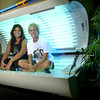 Karman Loyd and Amanda Davis at Tanfastic Tanning Salon Friday June 28, 2002. Les Hassell