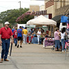 Shoppers browse the booths lining the downtown streets during the Old Glory Day festival in Carthage Saturday June 29, 2002. Les Hassell