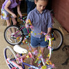 Victoria Ross, 7, right, and Jeannie Rathbun, 9, decorate their bicycles for a parade at the St. Luke's United Methodist Church Eggstravaganza Saturday March 30, 2002 in Kilgore. Les Hassell