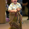 Be'la Free, 3, does his best to keep up with the older children in a Sack Race at the St. Luke's United Methodist Church Eggstravaganza Saturday March 30, 2002 in Kilgore. The Easter activities were moved indoors because of the weather. Les Hassell