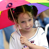 Rain didn't dampen the Easter spirit of Krystal Pate, 7, as she joined other children and their parents for a brief parade at the St. Luke's United Methodist Church Eggstravaganza Saturday March 30, 2002 in Kilgore. Les Hassell