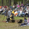 3-31-02-----Hundreds of people sit on the ground around the Teague Park pavillion joining together for worship and celebration.  BRIAN JENKINS