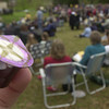 3-31-02-----The Lord's Supper is passed among the people at Teague Park in remembrance of Christ's last supper with his disciples.  Pictured here is a wafer (top) and grape juice packaged together.   BRIAN JENKINS