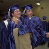 Spring Hill  High School senior John Fletcher jumps into the arms of fellow classmate Chris Smith as they prepare for graduation ceremonies Friday evening at Panther Stadium.  by DARLENE-5-31-02