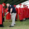 Kilgore High School senior Joey Chitwood , left, pulls back his gown as Gregg County Deputy Bill Jennings uses a metal detector as the graduates line up prior to the graduation Friday May 31, 2002 in Kilgore. Kevin green