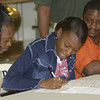 Sharon, left, and Shedric Pickett, right, look on while their daughter Shamonica Pickett signs Thursday May 30, 2002 at LHS in Longview. Newsjournal Photo