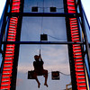 Ryan Forester, 13, of Hallsville, is silhouetted as he slides down the rappelling tower at Undergrad 2002. Les Hassell