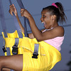 Ladacious Sheppard, 13, of Pine Tree, screams with excitement as she slides down the zip line at Undergrad 2002. Les Hassell