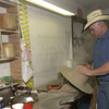 5-20-02 ----- Mike Helms shapes the crown of a hat in his custom hat shop at C&C Western Wear.  JUSTIN BAKER