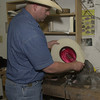 5-20-02 ----- Mike Helms shapes a hat in his custom hat shop at C&C Western Wear.  JUSTIN BAKER