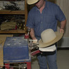 5-20-02 ----- Mike Helms uses a machine to sane the brim of a hat in his custom hat shop at C&C Western Wear.  JUSTIN BAKER