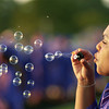 Charmyn Tumey blows bubbles while waiting for Pine Tree High School graduation ceremonies to begin Friday May 31, 2002 at Pirate Stadium. Les Hassell