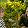 Eleanor and Logan Damewood pose beside one of the  many  flower beds at their home Thursday May 30, 2002 in Longview. Kevin Green