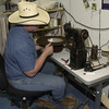 5-20-02 ----- Mike Helms sews ribbon edging onto the brim of a hat in his custom hat shop at C&C Western Wear.  JUSTIN BAKER