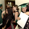 Eat Texas Charter High School graduate Polly Leveritt, right, gets a hug from her mom Nan, of Longview, after the graduation Friday May 31, 2002 in Longview. Kevin Gren