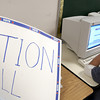 Longview High School senior Ismael Sifuentes, right, prepares to vote in a mock election Thursday October 31, 2002 at the school in Longview. Kevin green