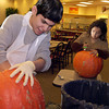 Miguel Reyna, left, and Mareie Gonzales carve pumpkins for a contest at Kilgore College Thursday October 31, 2002. Les Hassell