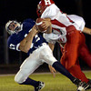 Union Grove's #17 is sacked by Harmony's #77  duirng the Friday September 27, 2002 game in Union Grove. Kevin Green