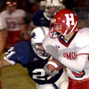 Union Grove's #21 attemps to tackle Harmony's #3 as he runs back an interception for a touchdown duirng the Friday September 27, 2002 game in Union Grove. Kevin Green