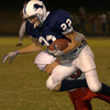 Union Grove's #22 trys to avoid a tackle by Harmony's #8 as he runs duirng the Friday September 27, 2002 game in Union Grove. Kevin Green