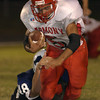 Union Grove's #48 attemps to tackle Harmony's #5 as he runs duirng the Friday September 27, 2002 game in Union Grove. Kevin Green