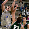 Spring Hill's #15 puts a shot up as Canton's #33 trys to block duirng action Monday December 29, 2003 in Longview. Kevin Green