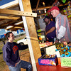 Kyle Adams, left, talks with Lonnie Kvapil, center, and Robbie Black about the fireworks sales business Tuesday December 30, 2003. (Les Hassell/News-Journal Photo)