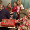 Adam Eudy,15, holds up  his great great grandmother's<br />  birthday cake, Minnie Johnson celebrated her 105th birthday Saturday December 27, 2003.  A party with cake, family and friends was held at her home in North Longview.(Darlene Chapman-Davis/News-Journal Photo)