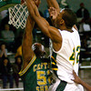 Longview's #42 dunks the ball adn draws a foul by Captain Shreve's #52 duirng action Monday December 29, 2003 in Longview. Kevin Green