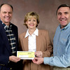 Keith Honey of Swepco donates $3200 to Jan Payton, and Dan Fiscus of Junior Achievement, 2-28-03. Ricardo B.Brazziell