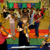 Fifth grade Valley View students Brittney Kennedy, left, Ashton Woodson, center, and KeAira Dixon, right, play their violins duirng class Friday January 31, 2003 in Longview. Kevin Green