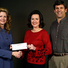 Jackie Hurlburt, form eastman Chemical, hands a check to Marila Palmer and Fred Jennings from GLOBE Texas Scholars Friday January 31, 2003.