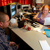 Peggy Calhoun helps Joshua Selman of Beckville prepare income tax statements for he and his wife Friday January 31, 2003. Les Hassell