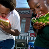 Josh Buffin, 13, and Cleveland King, 11, do battle in the watermelon eating contest Saturday, June 28, 2003 at the Old Glory Freedom Festival in Carthage. Les Hassell