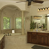The overiszed masterbath located at the home of Peggy and  Jeff Reich of Reich builders features a artful fill with hand paintings above tub.  by DARLENE-6-28-03