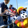 3-30-03 ----- Sparky the fire dog shakes hands with young fans during halftime at the 2003 Battle of the Bravest football game Sunday afternoon at Spring Hill Junior High's field.  JUSTIN BAKER