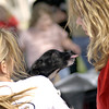 Robin Neeley, right, tries to make friends with Pepper, a young terrier being held by Bridget Stone Saturday March 29, 2003 during Paws on the Bayou in Jefferson. Les Hassell