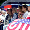 People gather outside of Gregg County Courthouse lawn for a memorial day service Monday 5-26-03. Ricardo B.Brazziell