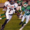 Gilmer's Manuel Johnson races around the end during the first half of Friday's November 28, 2003 playoff game against the Tatum Eagles in Tyler's Rose Stadium. (Les Hassell/News-Journal Photo)