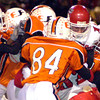 San Augustine quarterback Brandon Sharp is met in the backfield by a swarm of Yellow Jackets during the first half of Saturday's November 29, 2003 playoff game against Elysian Fields in Kilgore. (Les Hassell/News-Journal Photo)