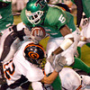 Tatum's Darryl Shelton fights for yardage during the first half of Friday's November 28, 2003 playoff game against the Gilmer Buckeyes in Tyler's Rose Stadium. (Les Hassell/News-Journal Photo)