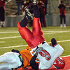 San Augustine's Calan Pickard lands hard as he dives into the endzone during the first half of Saturday's November 29, 2003 playoff game against Elysian Fields in Kilgore. (Les Hassell/News-Journal Photo)
