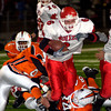 San Augustine's Calan Pickard fights through the elysian Fields defense during the first half of Saturday's November 29, 2003 playoff game in Kilgore. (Les Hassell/News-Journal Photo)