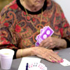 Lillian Logan places a card on the table during a game of bridge Monday September 29.2003. Ricardo B.Brazziell