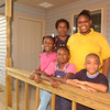 Noreen Jackson, back left, and her grandchildren AnJelika Finley, 13, back right, Alexis Colbert, 10, front left, Jamee Jimerson, 6, center, and DaKeindric Jimerson, 6, front right Tuesday September 30, 2003. (Les Hassell/News-Journal Photo)