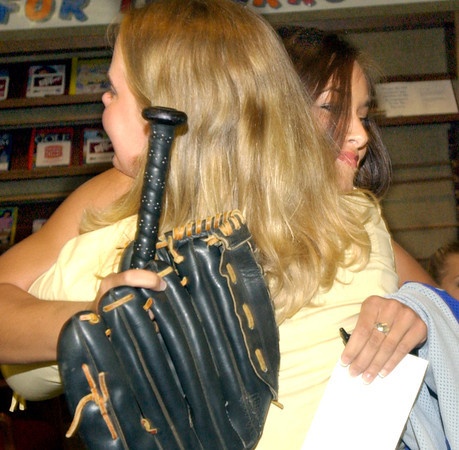 Spring Hill High School's Kristen Gaddis, left, and Kristen Akin congratulate each other Friday, April 30, 2004 in the school's library. Gaddis will be playing softball for Abilene Christian while Akin will join the UT Tyler program. (Les Hassell/News-Journal Photo)